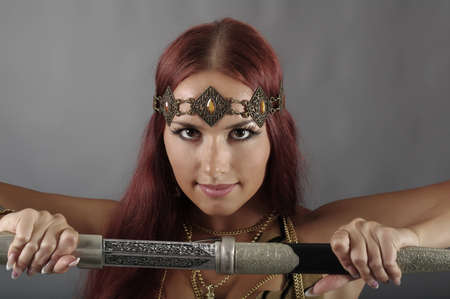young warrior woman holding sword in her hand Stock Photo - 10862852