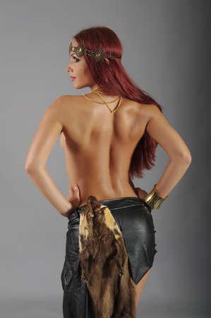 warrior pose: Sexy wild woman  amazon  .young warrior woman  Stock Photo
