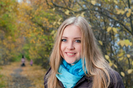 Young pretty blonde woman in the autumn park photo