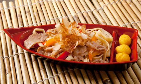 Japanese cuisine .box of fast food with with pork photo
