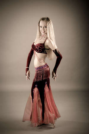Fashion girl in belly dance dress photo