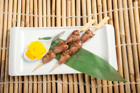 Japanese skewered.Grilled chicken hearts on skewers photo