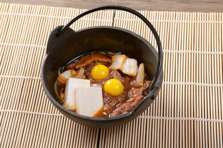 japanese quail: Japanese cuisine .beef with egg quail Stock Photo