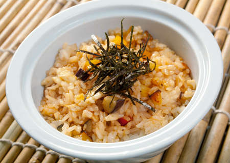 Japanese cuisine .freshly cooked bowl of rice  photo