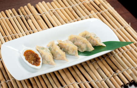 Dim-sum call Gyoza, asian tradition food.Fried Dumplings Chinese Style  photo