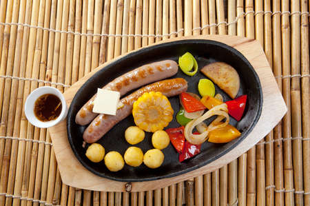 Japanese cuisine .Sausage making roasted with vegetable photo