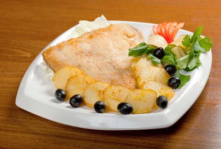 plaice: roasted plaice with potatoes.Italian cuisine