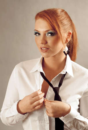 redheaded girl  in formal dress like a secretary with white shirt and tie Stock Photo - 11864993