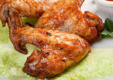 chicken wings with vegetable closeup photo