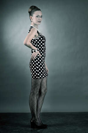 Girl in american 60s style in  polka dot dress  photo