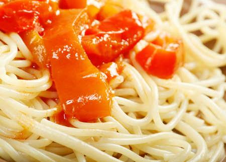 Close up spaghetti with tomato  paprika sauce  Shallow depth-of-field photo
