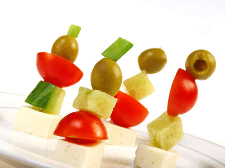 Canape platter with cheese, cucumber,tomato,olives. Shallow depth-of-field.  photo