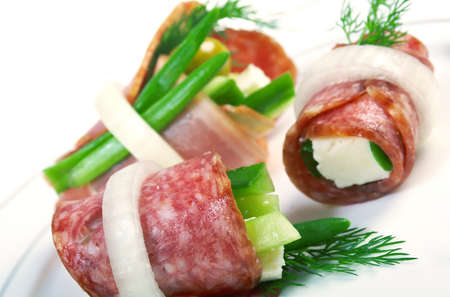 Canape platter with cheese, smoked sausage,cucumber,onion . Shallow depth-of-field.  photo