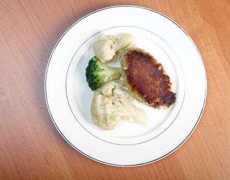Cutlets in a plate with vegetables.Close-up . photo
