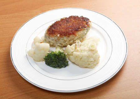 Cutlets in a plate with vegetables Close-up   photo