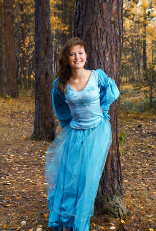 Very beautiful girl in medieval dress in autumn wood Stock Photo - 13519897