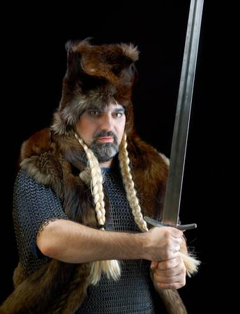 Cimmerian.barbarian  Warrior.Medieval knight in the armor with the sword.  Stock Photo