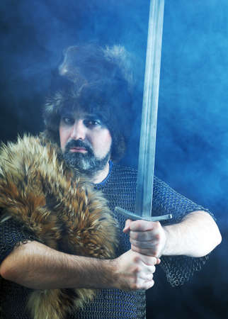 Cimmerian.barbarian  Warrior.Medieval knight in the armor with the sword.  photo