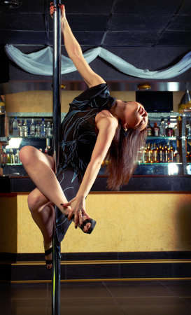 striptease in night club .Young slim pole dance woman Stock Photo - 13842855
