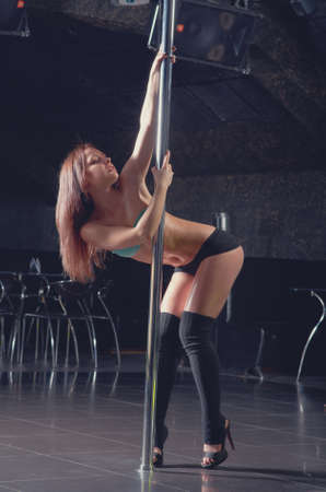 striptease in night club .Young slim pole dance woman Stock Photo - 13922011