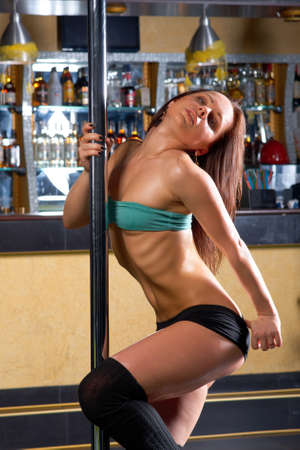 striptease in night club .Young slim pole dance woman Stock Photo - 14035530