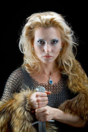 Valkyrie.Viking girl with sword photo