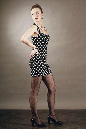 beautiful lady in a polka dot dress.  60s style  photo