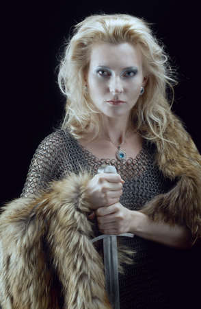 Valkyrie Viking girl with sword photo