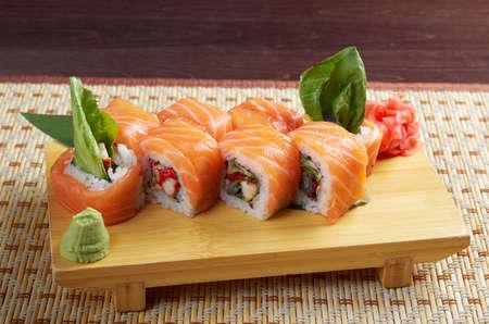 Uramaki. Philadelphia classic. Salmon, Philadelphia cheese, cucumber, avocado, tobiko. Japanese sushi