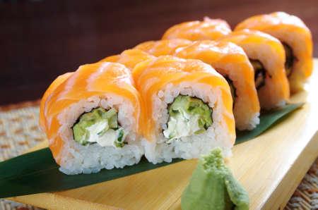 Uramaki. Philadelphia classic. Salmon, Philadelphia cheese, cucumber, avocado, tobiko. Japanese sushi Stock Photo - 15907019