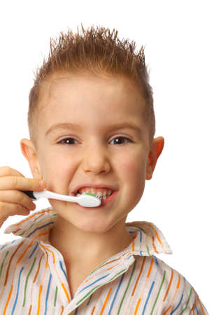 Little child with dental toothbrush brushing teeth.isolated on a white background. photo