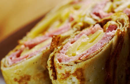 rolled pancakes stuffed ham and cheese. Shallow depth-of-field. photo