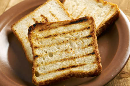pile  toasted bread slices for breakfast.Close up of toasted white bread in slices Stock Photo - 18622510