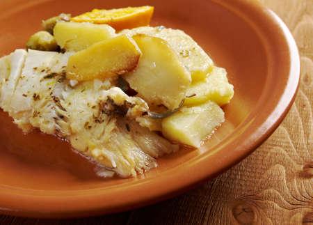 halibut: Fresh Halibut with sauce, potatoes,orange Stock Photo