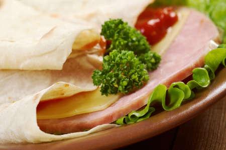 Pita Sandwich with cheese,ham,parsley,and tomato sauce Stock Photo - 19478248