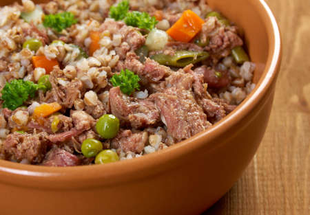 buckwheat: Russian Buckwheat porridge  vegetables und beef closeup Stock Photo