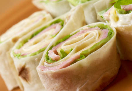 healthy club sandwich pita bread roll with cheese,ham,parsley Stock Photo - 19624361