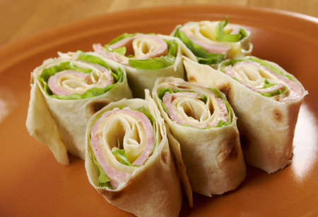 healthy club sandwich pita bread roll with cheese,ham,parsley photo