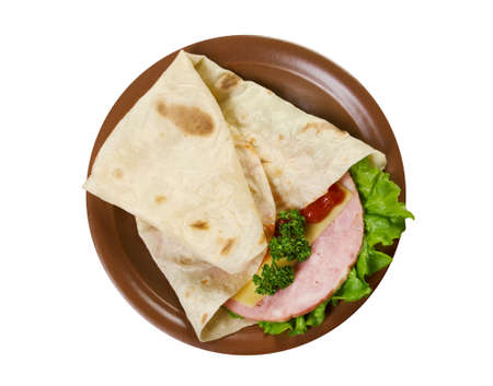 Pita Sandwich with cheese,ham,parsley,and tomato sauce.isolated photo