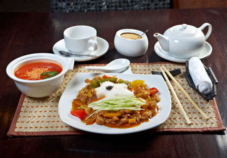 Chinese food style.lunch tomato soup puree and pork with vegetable photo