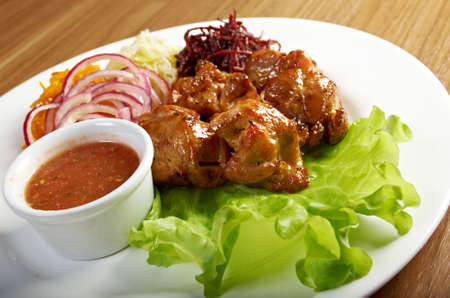 shish kebab: pork making roasted with vegetable closeup.Shashlik (shish kebab)