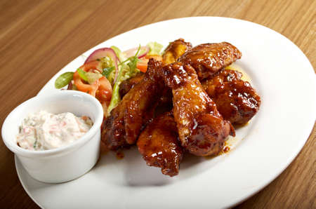 Roasted chicken wings on plate photo