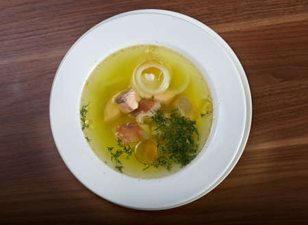 lucid: Ukha with sterlet , salmon . Russian homemade  traditional fish soup. Stock Photo