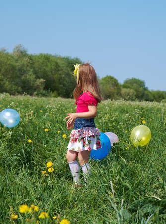 gir: small gir lwith colorful  air balloon outdoor
