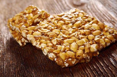 gozinaki: Peanut brittle sweet hard on wooden table Stock Photo