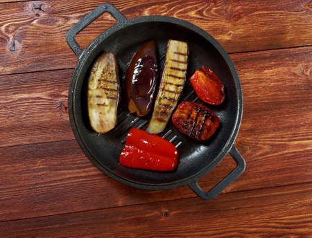 bell peppers: roasted eggplants with tomato and bell peppers . farm-style,farmhouse kitchen, Stock Photo