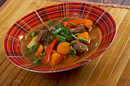 Irish stew farm-style  with tender lamb meat, potatoes and vegetables photo