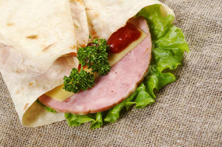 Pita Sandwich with cheese,ham,parsley,and tomato sauce photo