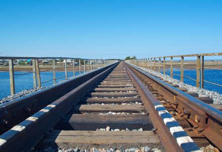 rail road bridge under cloudy blue sky photo