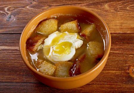 cazuela: sopa de ajo , castilian garlic soup.farm-style
